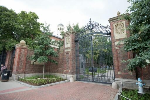 A gate in front of Harvard Yard at Harvard University, which is moving classes online because of the coronavirus epidemic