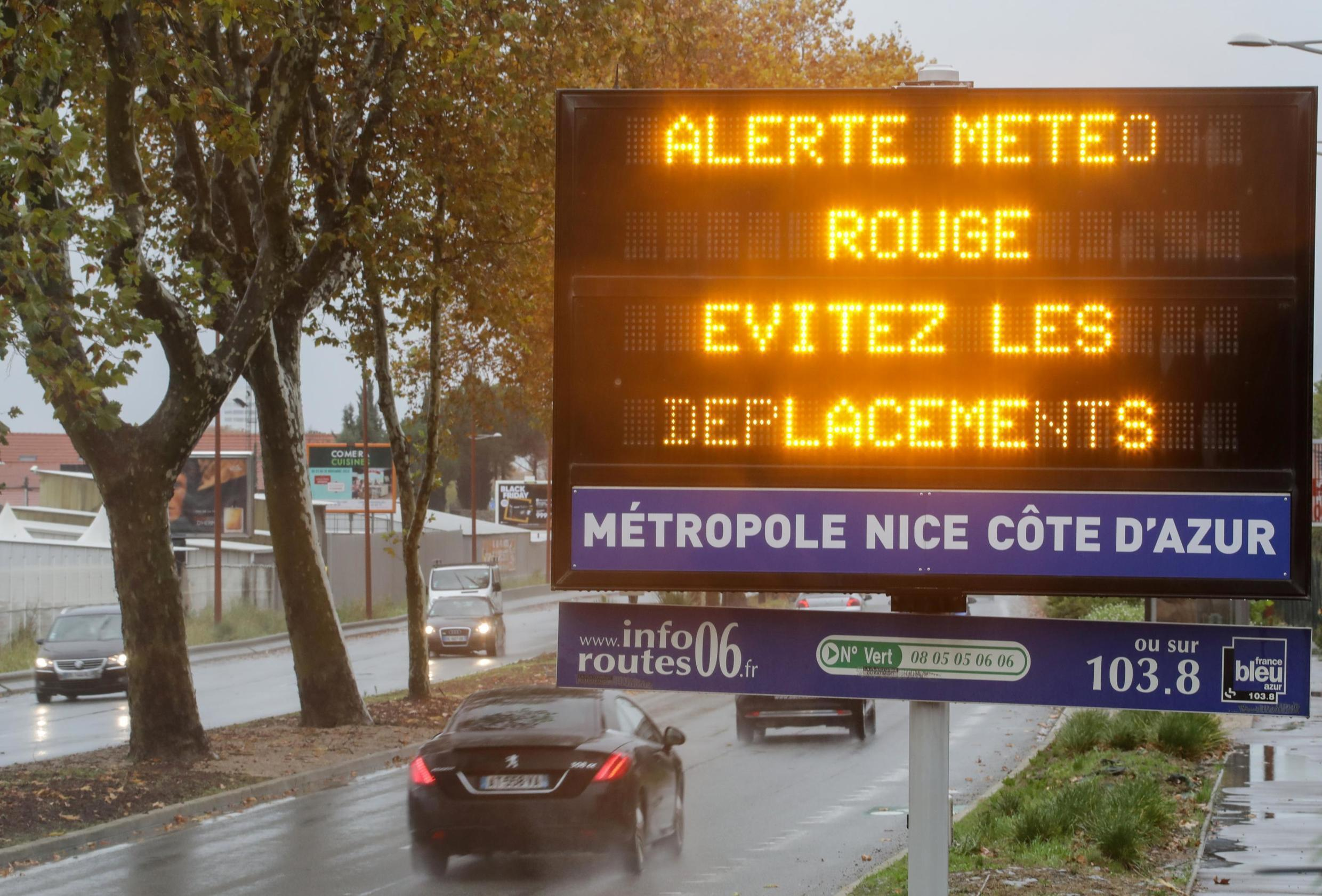 """A road sign reads """"Red alert, avoid your trips"""" as the french Riviera is under a red alert for heavy rain and floods, in Nice, France, December 1, 2019."""