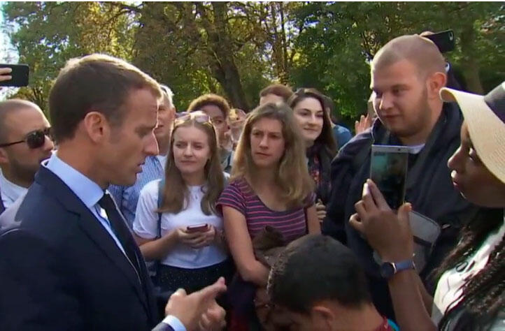 """Just cross the road and you'll find a job"", says Emmanuel Macron to an unemployed horticulturist, telling him to find jobs in restaurants and cafés. The remark was considered by many to be condescending. (Paris, September 2018)"