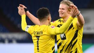 Striker Erling Braut Haaland (R) and England winger Jadon Sancho both scored in Dortmund's derby win on Saturday