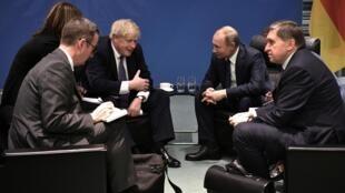 Первая встреча Бориса Джонсона и Владимира Путина состоялась в перерыве международной конференции по Ливии, 19 января 2020.