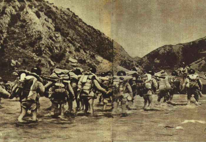 Troops of China's People's Liberation Army crossing the Mekong river near Chamdo, October 1950.