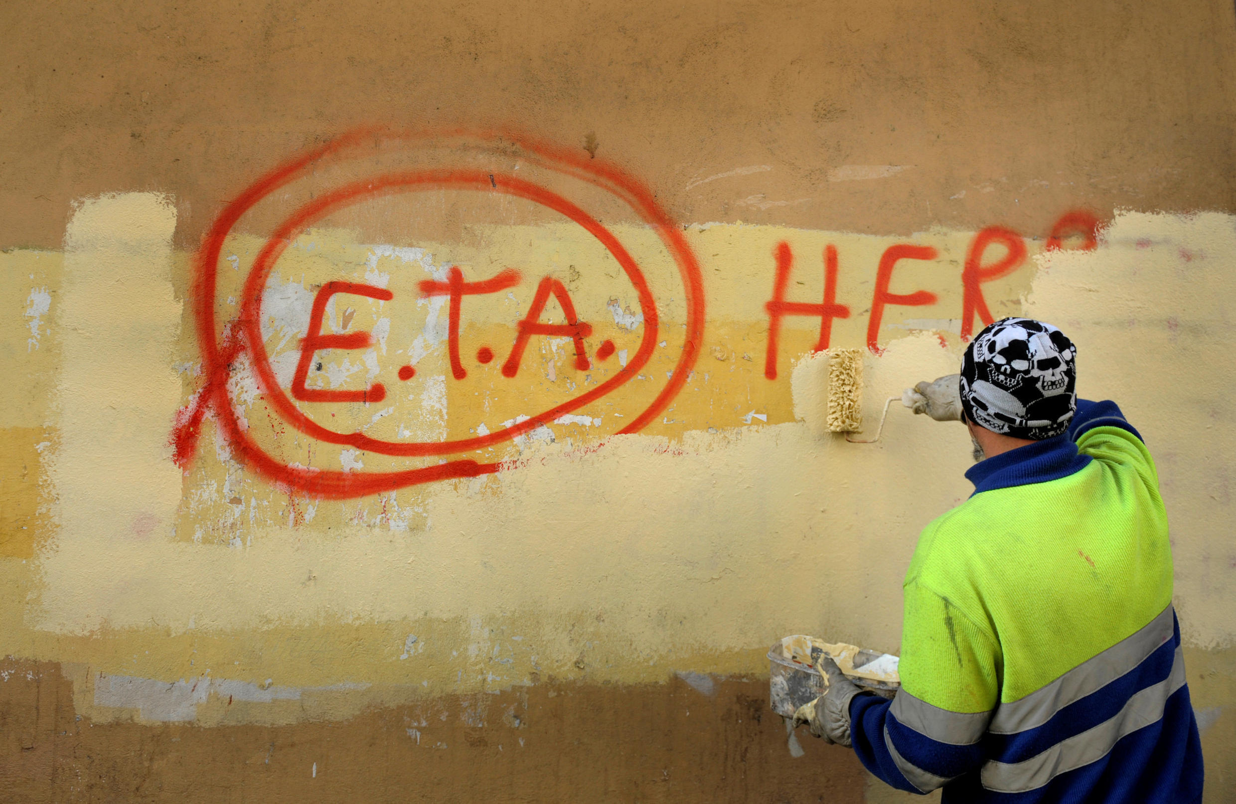 Pro-ETA graffiti is erased by a council worker in the Spanish Bassque town of Guernica in 2011