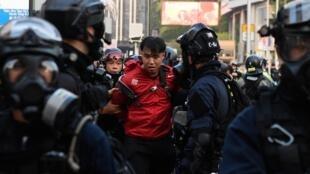 Ces officiers britanniques expatriés à Hong Kong sont accusés d'avoir directement supervisé la répression ordonnée par Pékin (photo d'illustration).