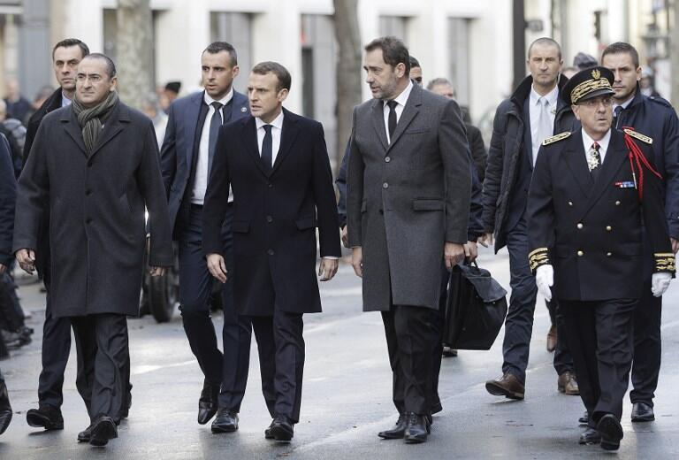 France's President Emmanuel Macron, France's Interior Minister Christophe Castaner, Secretary of State to the Interior Minister Laurent Nunez and Paris police prefect Michel Delpuech arrive to visit firefighters and police the day after a demo.
