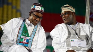 Muhammadu Buhari and Atiku Abubakar talk during the APC primaries in Lagos on 11 December 2014.