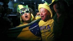 Brazilian fans celebrate the third goal of their team against Croatia