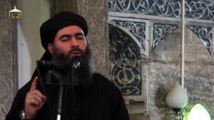 Chefe do grupo jihadista estado islâmico Abu Bakr al-Bagdhadi em Mossul, no Iraque, num vídeo délivrée de 5 de julho de 2014.