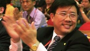 湖南三一集团董事长梁稳根 2005年在长沙出席会议照片