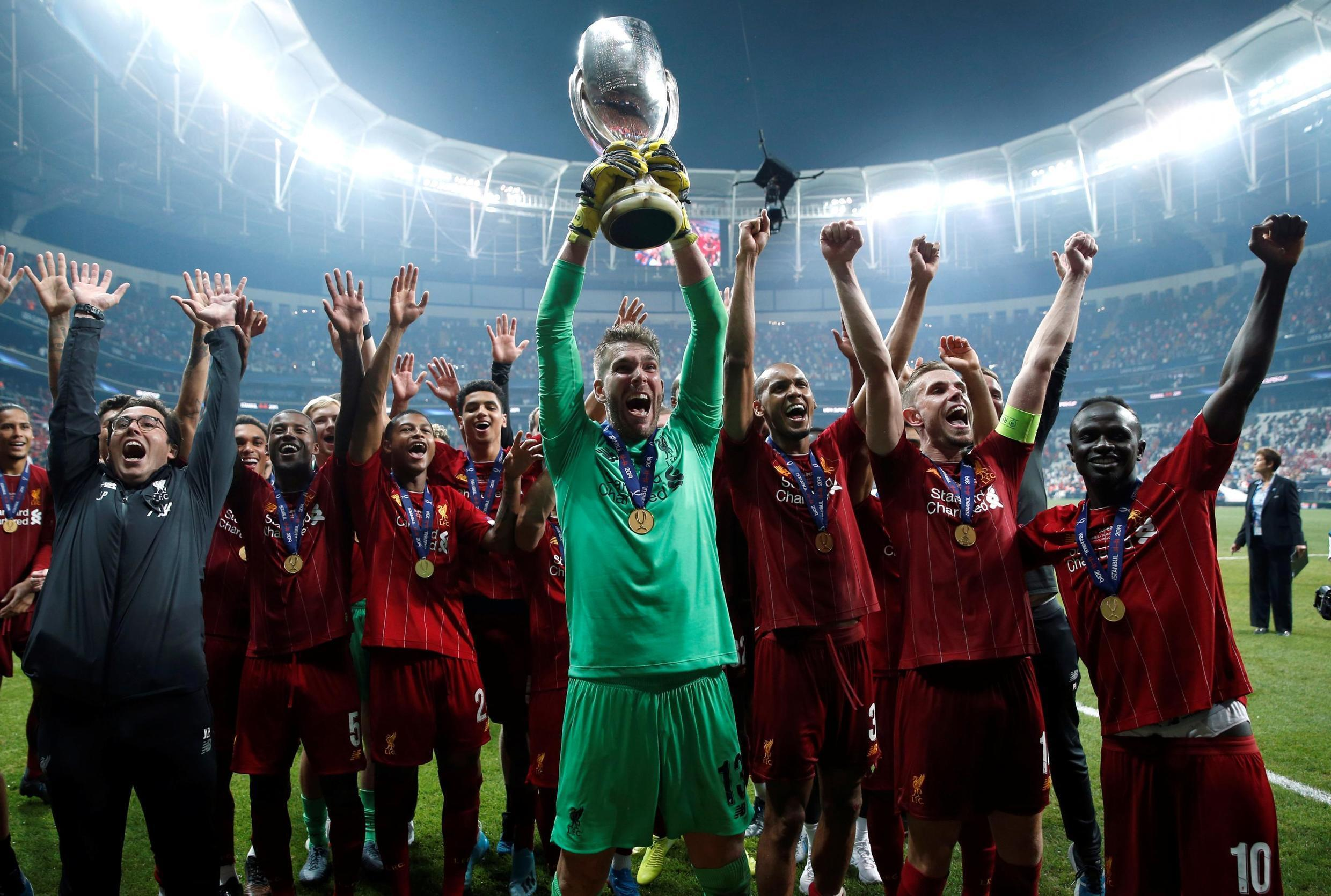 Soccer Football - UEFA Super Cup - Liverpool v Chelsea - Vodafone Arena, Istanbul, Turkey - August 14, 2019 Liverpool's Adrian lifts the trophy as he celebrates winning the UEFA Super Cup with team mates