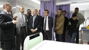 French consul-general Frederic Desagneaux (4th R) is shown the renovated emergency room of the Al-Quds hospital in Gaza City