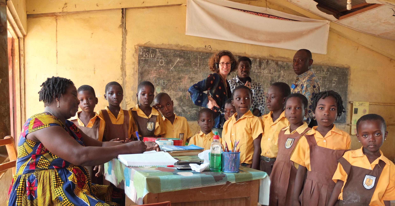 Teacher and classroom,  Anumle school in Achimota, Accra