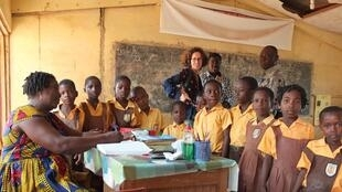 Teacher and classroom,  Anumle school in Achimota, Accra