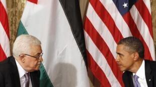 El presidente palestino Mahmud Abas y el mandario estadounidense, Barack Obama.
