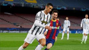Cristiano Ronaldo tare da Lionel Messi a yayin wasan zakarun Turai