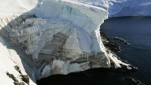 Melting ice shows through at a cliff face at Landsend, on the coast of Cape Denison in Antarctica January 2, 2010.