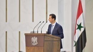 Bachar el-Assad, photographié le 26 juin à Damas lors de sa déclaration.