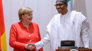 Presidente nigeriano Muhammadu Buhari com a chanceler alemã Angela Merkel a 31 de Agosto de 2018.