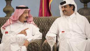 Saudi King Salman (L) chats with Emir of Qatar Sheikh Tamim bin Hamad al-Thani in Doha in December 2016, six months before the Gulf crisis erupted