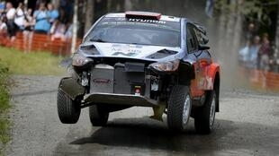 Dani Sordo drives a damaged car during the Rally of Finland.