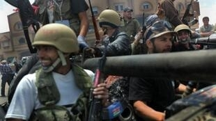 Jubliant Libyan rebels, after taking control of Misrata airport, 11 May 2011.
