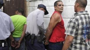 La Havane, 8 septembre 2011. Arrestation lors d'une procession religieuse annuelle en l'honneur de Notre-Dame-de-la-Charité, patronne de Cuba.