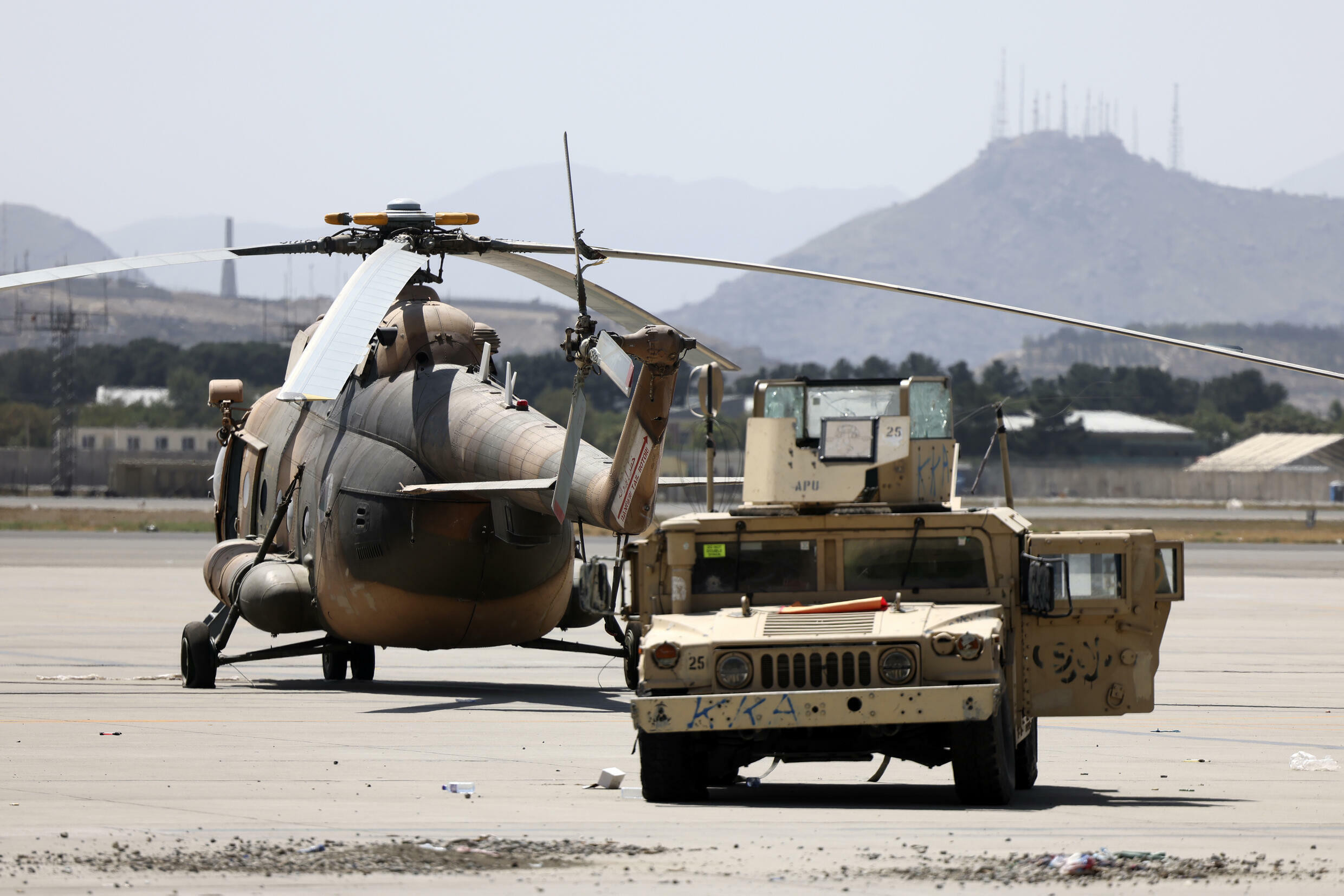 Dozens of damaged planes and vehicles were cordoned off by Taliban barricades
