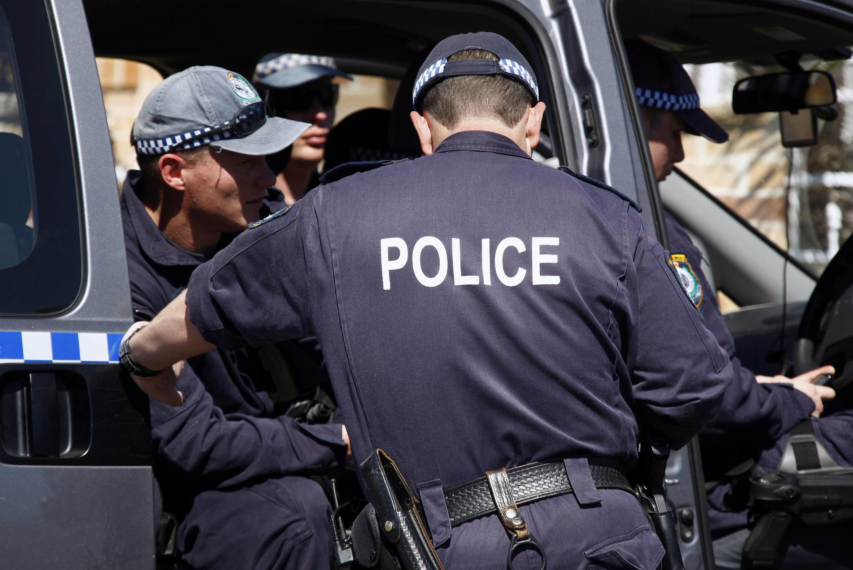 A Polícia Federal australiana durante a operação antiterrorista desta quinta-feira.
