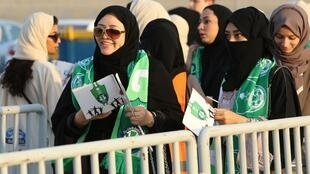 Female Saudi supporters of Al-Ahli queue at an entrance for families and women at the King Abdullah Sports City in Jeddah on January 12, 2018,