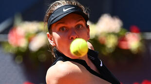 Romania's Simona Halep was beaten in three sets by Belgium's Elise Mertens at the Madrid Open