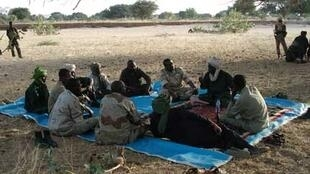 Rebels sitting in Darfur. Sudan's border with Libya runs through the region.