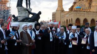 Les ecclésiastiques chrétiens et musulmans se rassemblent sur la place des Martyrs pour commémorer le 40ème anniversaire du début de la guerre civile au Liban, le 12 avril 2015.