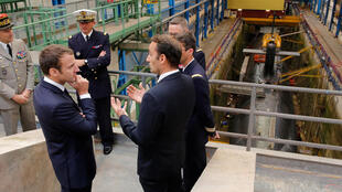 French President Emmanuel Macron views a nuclear submarine at the Ile Longue Defence unit near Brest, western France