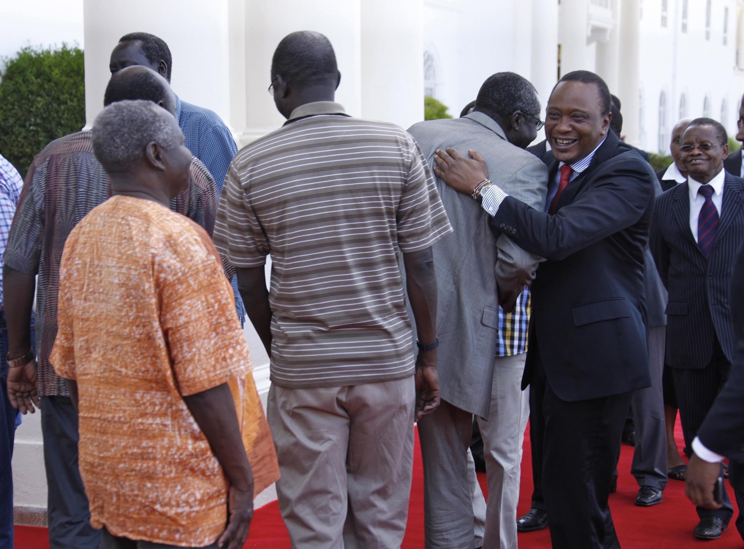 Kenya's President Uhuru Kenyatta (R) with South Sudan's former justice minister John Luk Jok after a news conference on the release of seven political detainees from South Sudan, Nairobi, 29 January, 2014