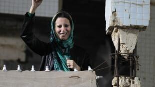 Aisha Kadhafi speaks to the crowd in Tripoli.
