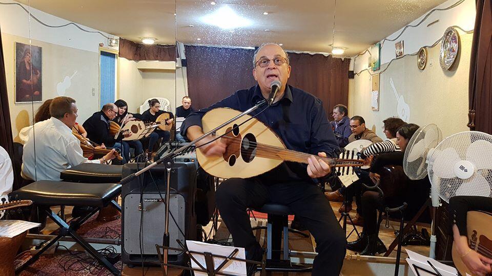 Musician Michel Arkash playing oud, Paris