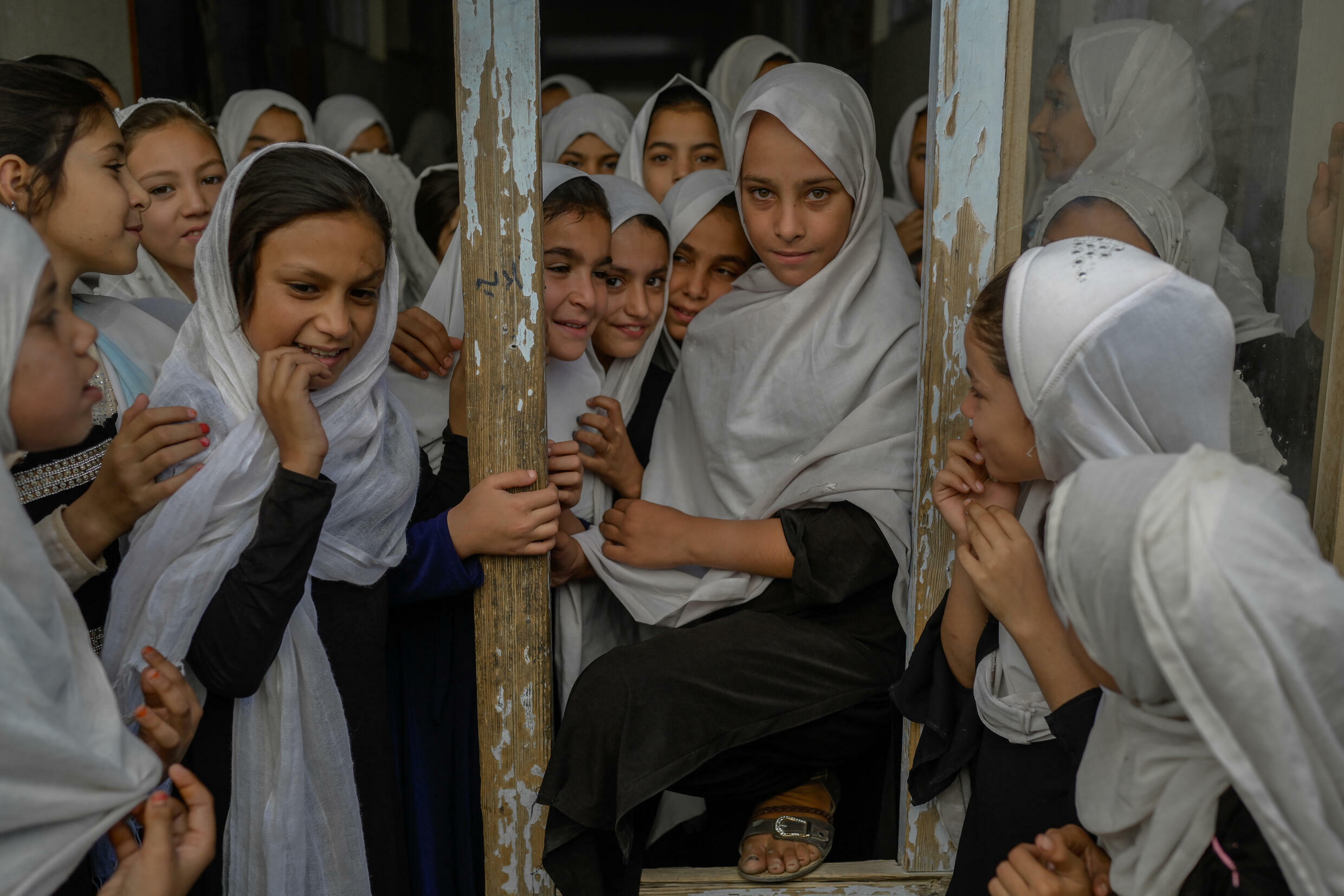 """The Taliban have imposed an extreme interpretation of sharia law during their last period of rule and this time round have said progress in women's rights will be respected """"within the framework of Islamic law"""""""