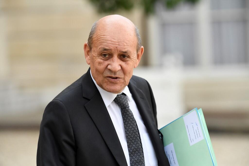 France's Foreign Minister Jean-Yves Le Drian gestures as he leaves The Elysee Presidential Palace in Paris.