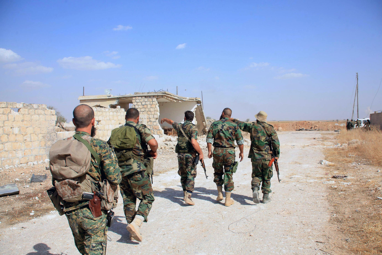 Солдаты правительственных сирийских войск к востоку от Алеппо, октябрь 2015 г.