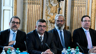 President of the Government of New Caledonia Philippe Germain (centre) sits with New Caledonian Senator Gerard Poadja (2nd right) and New Caledonian politician Philippe Gomes (right) during a meeting in Paris on March 27, 2018.
