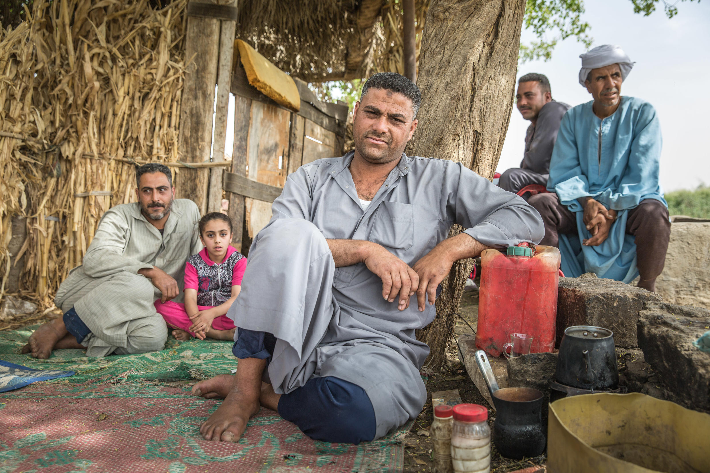 Family of farmers take a break in the Egyptian village of Riad Basha