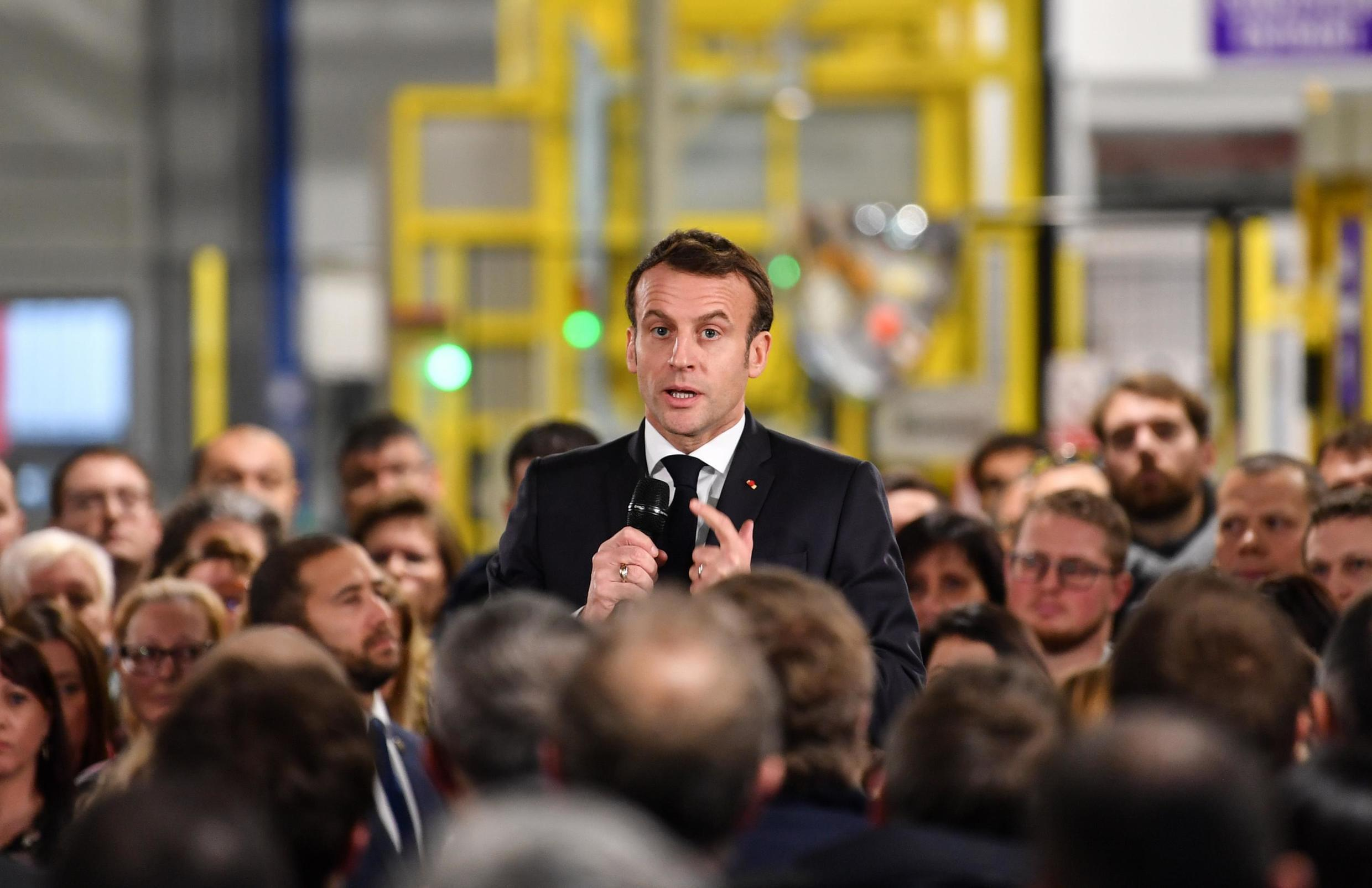 """French President Emmanuel Macron speaks during a visit at the AstraZeneca factory in Dunkirk, northern France, on January 20, 2020, before the summit """"Choose France""""."""