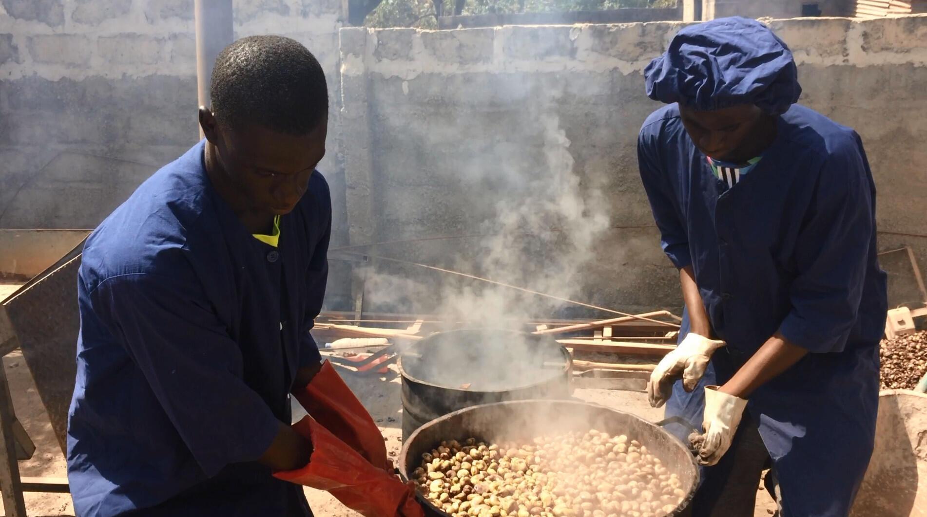 A barrel of steaming cashews.