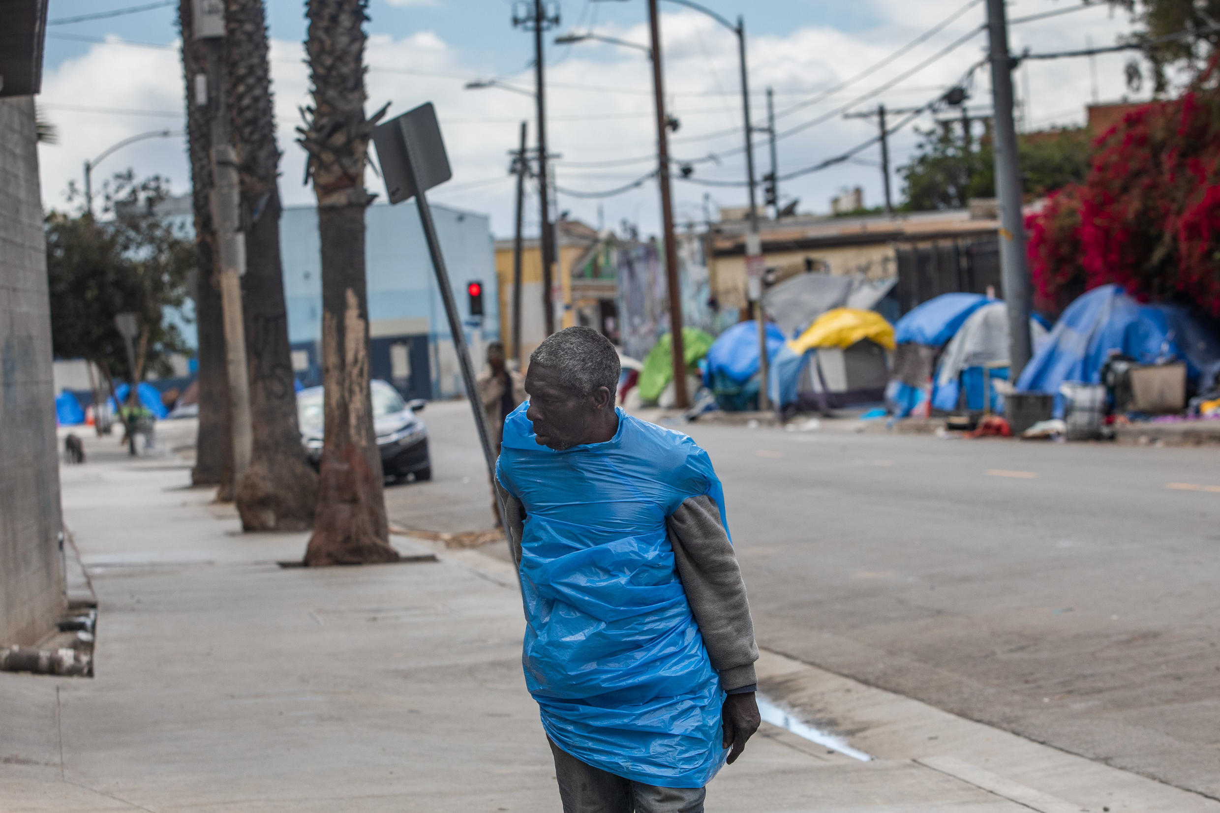 California's homeless population of 150,000 is the largest in the nation, some 60,000 of whom live in Los Angeles County - like this man on San Julian Street in the Skid Row area in downtown Los Angeles