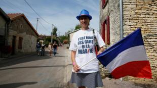 Une supportrice de Marine Le Pen lors d'un meeting à Brachay, le 3 septembre dernier.