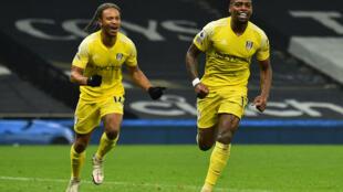 Fulham's Ivan Cavaleiro (R) celebrates scoring against Tottenham