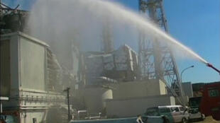 A water cannon attempts to cool Reactor No. 3 at the Fukushima nuclear plant in Japan.