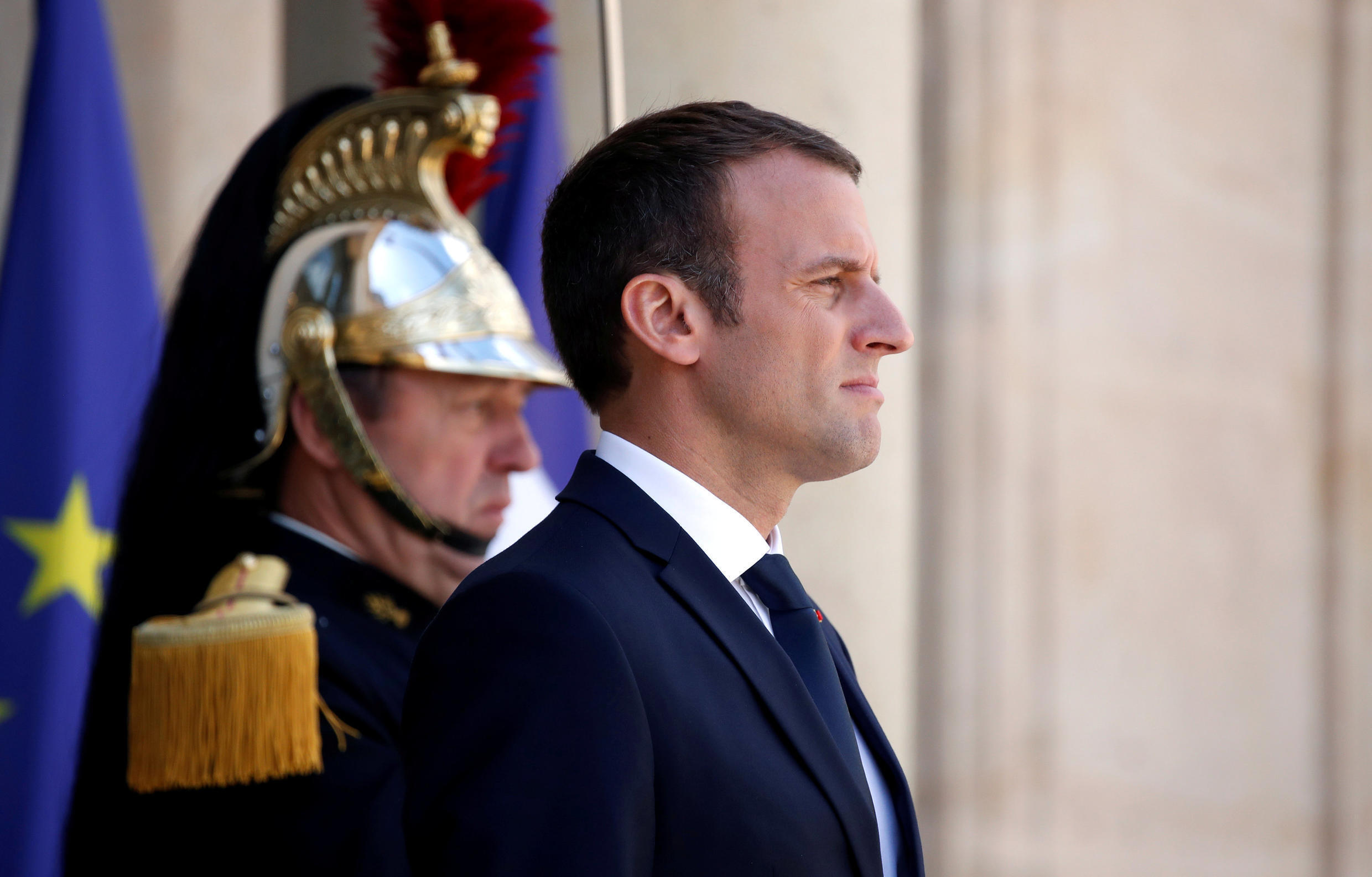French President Emmanuel Macron stands on the steps of the Elysee Palace in Paris, France, June 16, 2017.