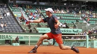 Andy Murray of Britain returns the ball to Jarkko Nieminen of Finland during the French Open tennis tournament