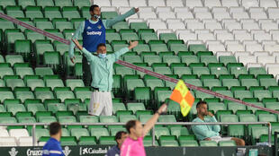 Empty feeling: Real Betis' Spanish midfielder Joaquin (centre) gestures from the stands